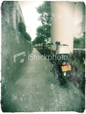 stock-photo-22091588-electric-bicycle-with-licence-plate-on-the-footpath