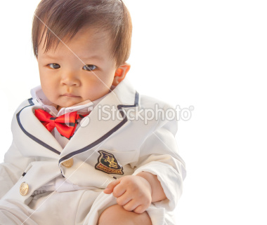 stock-photo-22196064-cute-baby-with-serious-look