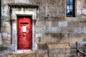 stock-photo-23293188-red-mailbox-on-wall
